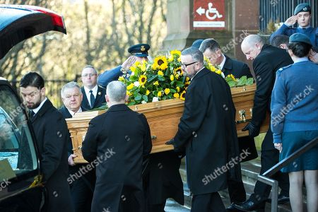 Ken Dodd's coffin is carried away from Liverpool Cathedral after the service