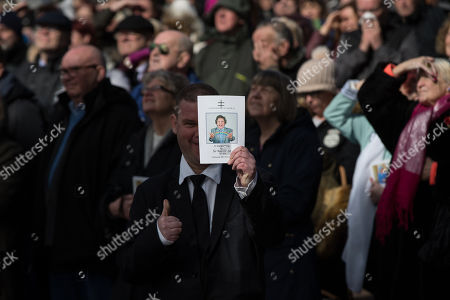 Fans and friends watch Ken Dodd's funeral on a big screen outside Liverpool Cathedral