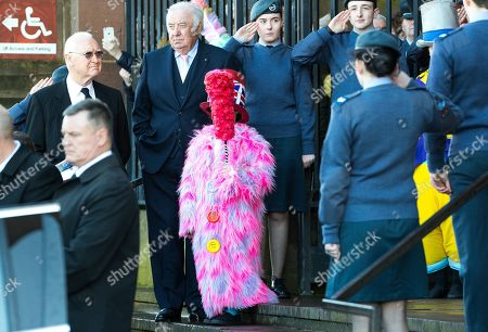 Children dressed as Diddy Men line up outside Liverpool Cathedral after the service