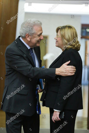 (L-R) EU Commissioner for Migration, Home Affairs and Citizenship, Dimitris Avramopoulos (L) and  EU Commissioner for Regional Policy Corina Cretu (R) during weekly college meeting of the European commission in Brussels, Belgium, 28 March 2018.