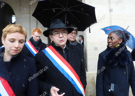 French far left leaders, from the left, Clementine Autain, Adrien Quatennens, party leader Jean-Luc Melenchon, Eric Coquerel and Daniele Obono arrive at a national ceremony for Beltrame, at the Hotel des Invalides in Paris. The slain hero of last week's extremist attack in southern France will be posthumously awarded the Legion of Honor by French President Emmanuel Macron during a solemn day-long national homage to him