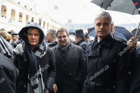 French European MP, Nadine Morano, Christian Jacob center, and French right-wing Les Republicains party leader Laurent Wauquiez, right, attend a ceremony for late Lt. Col. Arnaud Beltrame at the Hotel des Invalides in Paris. The slain hero of last week's extremist attack in southern France is being honored in an elaborate, daylong national homage led by French President Emmanuel Macron