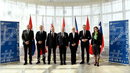 (L-R) Croatian Deputy Minister of Defence Petar Mihatov, Polish Deputy Minister of National Defence Tomasz Szatkowski,  Peter Gajdos Slovakian Defence Minister, Istvan Simicsko Hungarian Defence Minister, Karla Slechtova Czech Defence Minister, Austrian Minister of Defence Mario Kunasek and Andreja Katic Slovenian Defence Minister pose for group photos during the joint defence ministerial meeting of the Visegrad Group (V4) and the Central European Defence Cooperation (CEDC) in Stefania Palace in Budapest, Hungary, 28 March 2018.