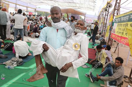 One of the Indian activists named Mohamed Farooq being taken to the hospital after his blood pressure gone critically low during his hunger strike to support Indian veteran social activist Anna Hazare (Unseen) who is sitting on the sixth day of his indefinite hunger strike at Ramlila Maidan, in New Delhi, India, 28 March 2018. According to a news report, Anna Hazare is on an indefinite hunger strike as he demands for a stronger Lokpal or Anti-graft bill and better conditions for farmers in India.