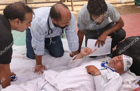 One of the Indian activists refusing to go to the hospital as doctor examine him during his hunger strike to support Indian veteran social activist Anna Hazare (Unseen) who is sitting on the sixth day of his indefinite hunger strike at Ramlila Maidan, in New Delhi, India, 28 March 2018. According to a news report, Anna Hazare is on an indefinite hunger strike as he demands for a stronger Lokpal or Anti-graft bill and better conditions for farmers in India.