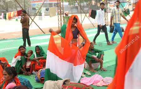 One of the Indian activists adjust her sari as she participate in a protest to support Indian veteran social activist Anna Hazare (Unseen) who is sitting on the sixth day of his indefinite hunger strike at Ramlila Maidan, in New Delhi, India, 28 March 2018. According to a news report, Anna Hazare is on an indefinite hunger strike as he demands for a stronger Lokpal or Anti-graft bill and better conditions for farmers in India.