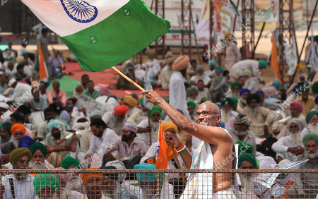 Indian activists waves Indian National flag as they are present to support Indian veteran social activist Anna Hazare (Unseen) who is sitting on the sixth day of his indefinite hunger strike at Ramlila Maidan, in New Delhi, India, 28 March 2018. According to a news report, Anna Hazare is on an indefinite hunger strike as he demands for a stronger Lokpal or Anti-graft bill and better conditions for farmers in India.