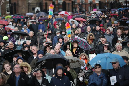 Stock Image of A crowd watches the service on a big screen outside Liverpool Cathedral . The funeral of comedian and performer Sir Ken Dodd , who died on 11th March 2018 at the age of 90 .
