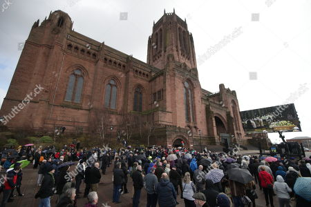 A crowd watches the service on a big screen outside Liverpool Cathedral . The funeral of comedian and performer Sir Ken Dodd , who died on 11th March 2018 at the age of 90 .