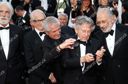 Stock Picture of Michael Haneke, Ken Loach, Claude Lelouch, Roman Polanski, Jerry Schatzberg. Previous former Palme d'or winners from left, Michael Haneke, Ken Loach, Claude Lelouch, Roman Polanski and Jerry Schatzberg pose for photographers upon arrival at the 70th Anniversary of the film festival, Cannes, southern France
