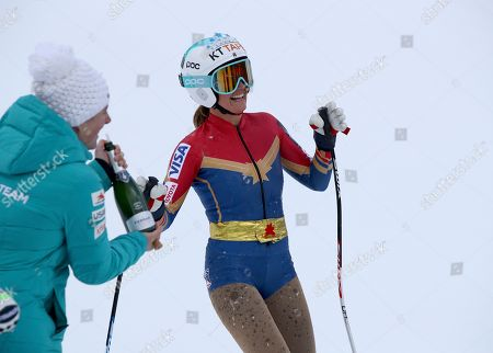 Stock Image of United States' Julia Mancuso is sprayed with sparkling wine as she completes an alpine ski, women's World Cup downhill, in Cortina D'Ampezzo, Italy, Friday, Jan.19, 2018. Mancuso announced she will retire from skiing after a goodbye run in a World Cup downhill Friday