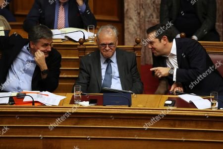 Alexis Tsipras, Euclid Tsakalotos, Giannis Dragasakis. Greece's Prime Minister Alexis Tsipras, right, speaks with Finance Minister Euclid Tsakalotos, left, as Deputy Prime Minister Giannis Dragasakis listens during a parliament debate in Athens, on . Greek lawmakers are set to vote Tuesday on the country's 2018 budget, which includes further austerity measures beyond the official end of Greece's third international bailout next summer