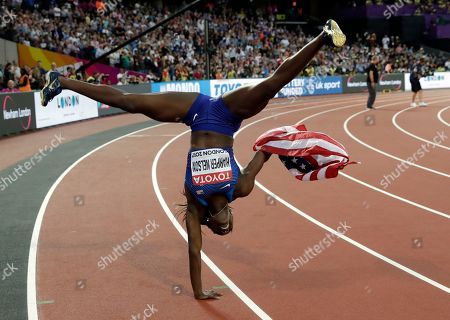Stock Picture of United States' Dawn Harper Nelson celebrates after winning the silver medal in the women's 100-meter hurdles final during the World Athletics Championships in London