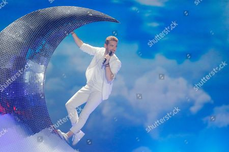 """Stock Image of Nathan Trent from Austria performs the song """"Running on Air"""" during the Final for the Eurovision Song Contest, in Kiev, Ukraine"""