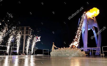 South Korean Olympic figure skating champion Yuna Kim lights the Olympic flame during the opening ceremony of the 2018 Winter Olympics in Pyeongchang, South Korea