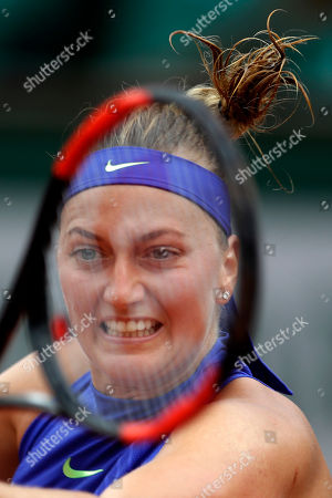 Petra Kvitova of the Czech Republic returns the ball to Julia Boserup, of the U.S, in their first round match of the French Open tennis tournament at the Roland Garros stadium, in Paris