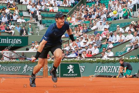 Britain's Andy Murray runs to return the ball against Russia's Andrey Kuznetsov during their first round match of the French Open tennis tournament at the Roland Garros stadium, in Paris, France
