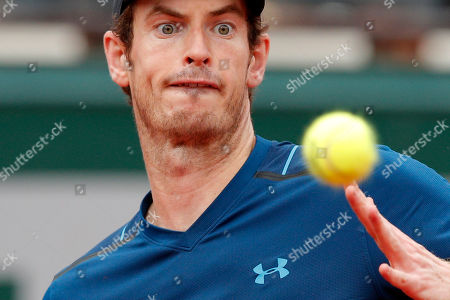 Britain's Andy Murray eyes the ball as he plays Russia's Andrey Kuznetsov during their first round match the French Open tennis tournament at the Roland Garros stadium, in Paris