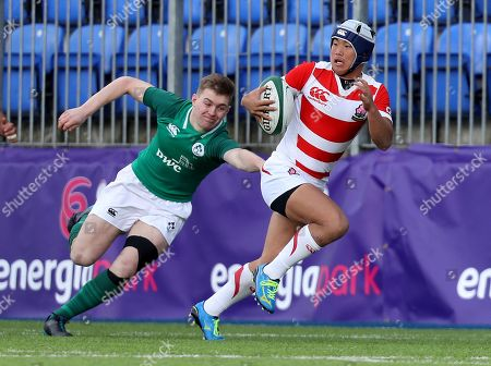 Ireland U19 vs Japan U19 . Japan's Keita Inayoshi with Conor Kelly of Ireland