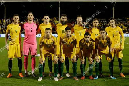 Australia's, back row left to right, Tomi Juric, Bradley Jones, Tom Rogic, Mile Jedinak, Milos Degenek, Josh Risdon, Mathew Leckie and, front left to right, Andrew Nabbout, Massimo Luongo, Aziz Behich, Mark Milligan, during the national anthems before a friendly soccer match between Colombia and Australia in London
