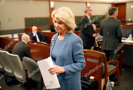Elaine Wynn, ex-wife of Steve Wynn, leaves a hearing, in Las Vegas. Elaine Wynn has accused her ex-husband and others of getting her off the company's board of directors in 2015 because of her inquiries into company activities. She has claimed that she was not re-nominated to be a board member that year as a result of retaliation