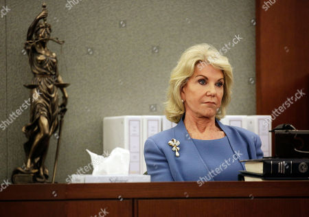 Elaine Wynn, ex-wife of Steve Wynn, listens during a hearing, in Las Vegas. Elaine Wynn has accused her ex-husband and others of getting her off the company's board of directors in 2015 because of her inquiries into company activities. She has claimed that she was not re-nominated to be a board member that year as a result of retaliation