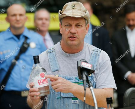 Timn Smith. Climax Spirits founder, Tim Smith, holds a bottle of his m moonshine that he developed in partnership with Richmond International raceway during a news conference in Richmond, Va., . The Discovery Channel personality teamed way with the racetrack for a party deck for the upcoming NASCAR Cup race in April