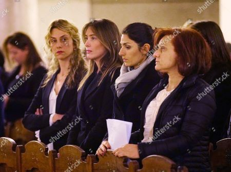 From right, the President of the Jewish community of Rome Ruth Dureghello, Rome's Mayor Virginia Raggi, Maria Elena Boschi and Marianna Madia attend a commemoration in memory of Holocaust survivor Mireille Knoll, the 85-year-old woman who escaped the Nazis 76 years ago but was stabbed to death and burned last week in her Paris apartment, at the Great Synagogue of Rome, Italy