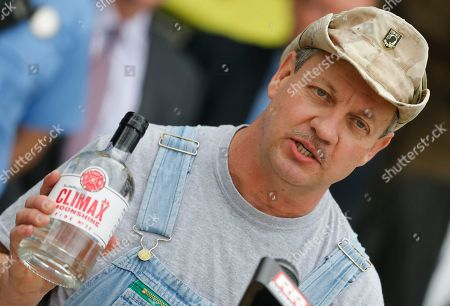 Timn Smith. Climax Spirits founder, Tim Smith, holds a bottle of his moonshine that he developed in partnership with Richmond International raceway during a news conference in Richmond, Va., . The Discovery Channel personality teamed way with the racetrack for a party deck for the upcoming NASCAR Cup race in April