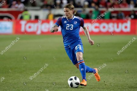 Iceland's Ari Skulason runs with the ball against Peru during the second half of an international friendly soccer match, in Harrison, N.J. Peru won 3-1