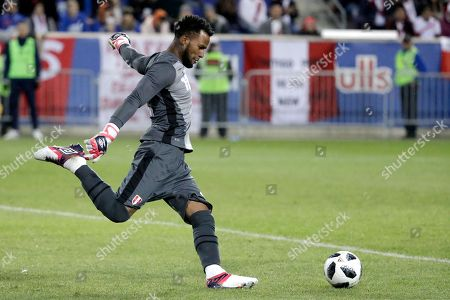 Peru goalkeeper Carlos Caceda clears the ball during the second half of an international friendly soccer match against Iceland, in Harrison, N.J. Peru won 3-1