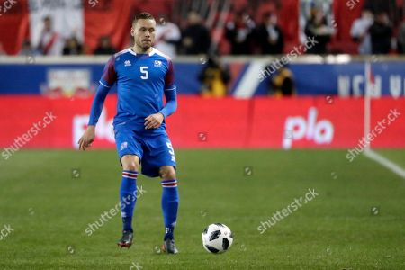 Stock Picture of Iceland's Sverrir Ingi Ingason chases after the ball during the second half of an international friendly soccer match against Peru, in Harrison, N.J. Peru won 3-1