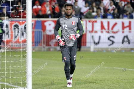 Peru goalkeeper Carlos Caceda competes against Iceland during the second half of an international friendly soccer match, in Harrison, N.J. Peru won 3-1