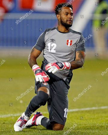 Peru goalkeeper Carlos Caceda in action against Iceland during the first half of an international friendly soccer match, in Harrison, N.J
