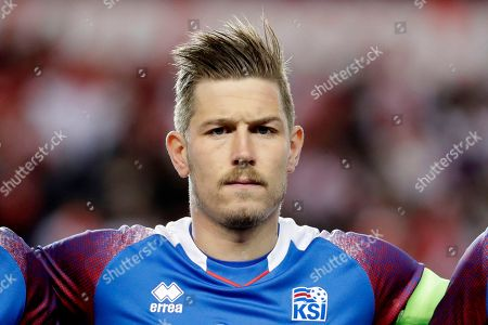 Iceland's Olafur Skulason looks on during the play of the national anthem prior to an international friendly soccer match against Peru, in Harrison, N.J
