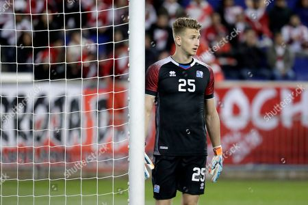 Stock Photo of Iceland goalkeeper Frederik Schram stands near his post during the first half of an international friendly soccer match against Peru, in Harrison, N.J