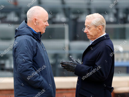 Sandy Alderson, Fred Wilpon. New York Mets general manager Sandy Alderson, left, talks with Mets majority owner and CEO Fred Wilpon on the field during a team workout at Citi Field, in New York. The team's opening day is Thursday against the St. Louis Cardinals