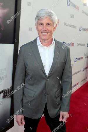 John Curran, Director,