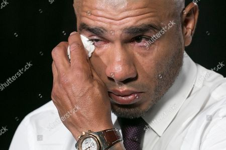 Boxer Miguel Cotto wipes away tears during an interview, in New York. Cotto will bid farewell to the ring after facing Sadam Ali in a junior middleweight bout on Dec. 2 at Madison Square Garden