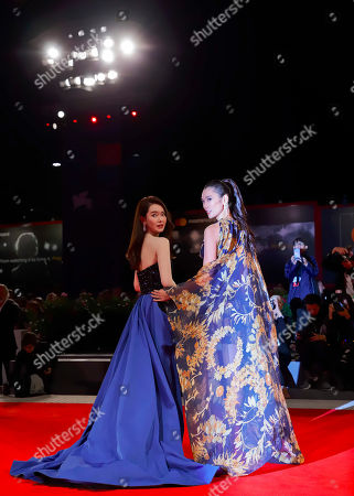 """Qi Wei, Tao Okamoto. Actresses Qi Wei, left, and Tao Okamoto pose for photographers at the premiere for the film """"Zhuibu"""" (Manhunt) at the 74th edition of the Venice Film Festival in Venice, Italy"""