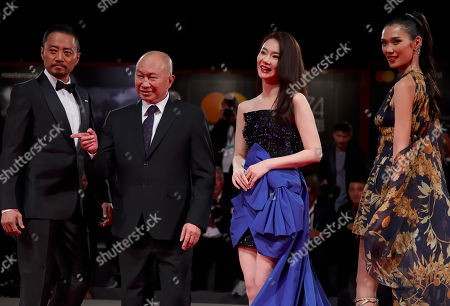 """Qi Wei, Tao Okamoto, John Woo, Zhang Hanyu. From left, actor Zhang Hanyu, director John Woo, and actresses Qi Wei and Tao Okamoto pose for photographers at the premiere for the film """"Zhuibu"""" (Manhunt) at the 74th edition of the Venice Film Festival in Venice, Italy"""