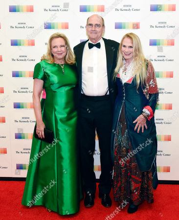 Kim Taylor, James Taylor, Kate Taylor. Kennedy Center Honoree James Taylor, center, his wife Caroline Kim Taylor and his sister, Kate Taylor, arrive at the State Department for the Kennedy Center Honors gala dinner on in Washington