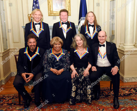 Al Pacino, Joe Walsh, Mavis Staples, Don Henley, Martha Argerich, Timothy Schmit, James Taylor. The 2016 Kennedy Center Honorees, front row, from left, Al Pacino, Mavis Staples, Martha Argerich and James Taylor, back row, from left, Joe Walsh, Don Henley and Timothy Schmit are photographed at the State Department for the Kennedy Center Honors gala dinner, in Washington