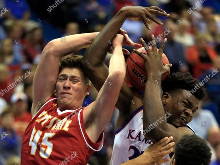 Jonathan Murray, Udoka Azubuike. Pittsburg State forward Jonathan Murray (45) rebounds against Kansas center Udoka Azubuike, right, during the first half of an exhibition NCAA college basketball game in Lawrence, Kan