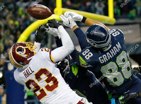 DeAngelo Hall, Jimmy Graham. Washington Redskins free safety DeAngelo Hall (23) breaks up a pass in the end zone intended for Seattle Seahawks tight end Jimmy Graham (88) at the end of an NFL football game, in Seattle. Washington won 17-14