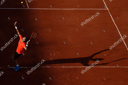 Brazil's Thomaz Bellucci serves against France's Lucas Pouille in their second round match of the French Open tennis tournament at the Roland Garros stadium in Paris, France