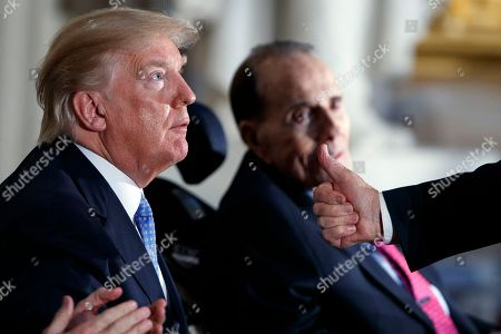 Donald Trump, Bob Dole. Sen. Pat Roberts, R-Kan., gives a thumbs up to President Donald Trump after speaking to honor former Sen. Bob Dole during the Congressional Gold Medal ceremony on Capitol Hill, in Washington