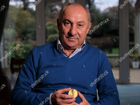 Ossie Ardiles holding his 1978 World Cup medal