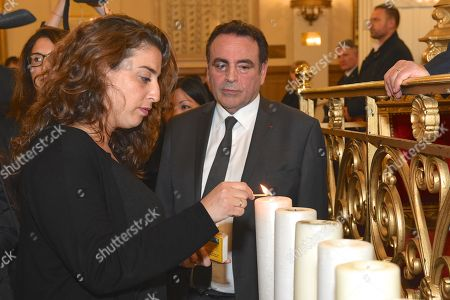 Granddaughter of Myriam Knoll ligthing a candle in memory of her grandmother Myriam Knoll and Joel Mergui. Synagogue des Tournelles in Paris during a service in memory of Mireille Knoll, the 85-year-old Jewish woman murdered in her home in what police believe was an anti-Semitic attack