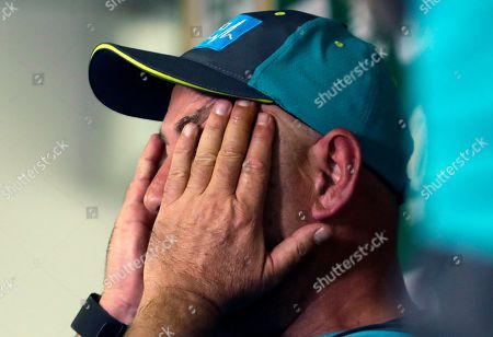 Australia's coach Darren Lehmann, reacts as he speaks, during a media conference in Johannesburg, South Africa, . Lehmann says he will quit after the final test against South Africa, citing the emotional stress of the ball-tampering scandal in South Africa